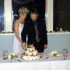 Andrea and Ryan cut the cake